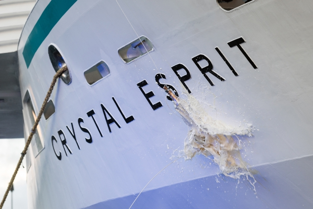A bottle of Louis Roederer, Cristal Brut, 2004 smashes against the hull of the yacht during her christening ceremony