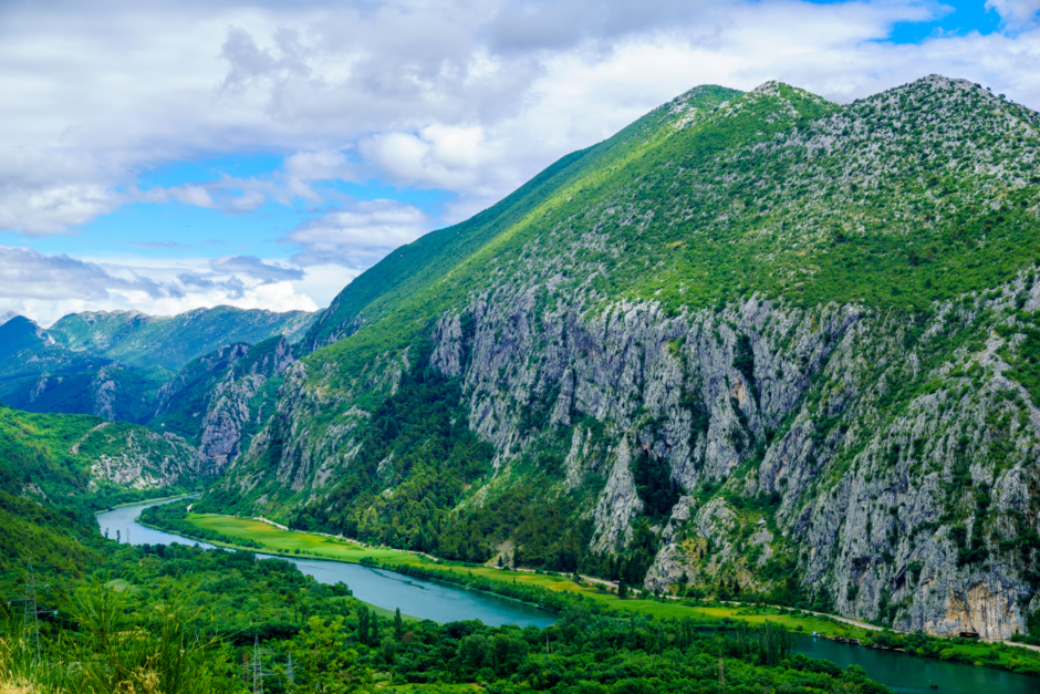 Rugged cliffs stretch high above the Cetina River in Omis, calling climbers of all levels to conquer them.
